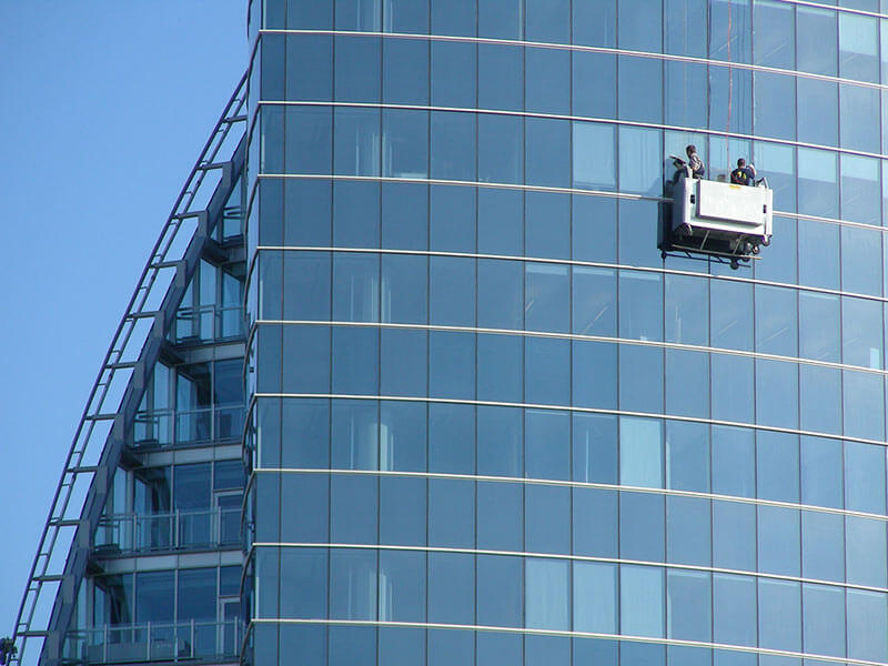Cleaning a high rise office block in a cradle